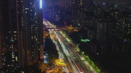Large avenue that crosses a giant city at night