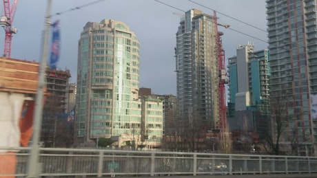 Large buildings from the window of a train