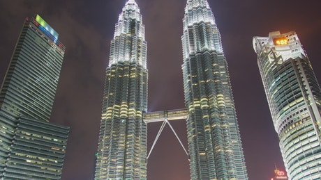 Large buildings lit up at night