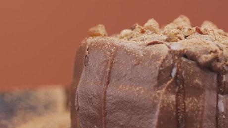 Large knife splitting a small chocolate cake