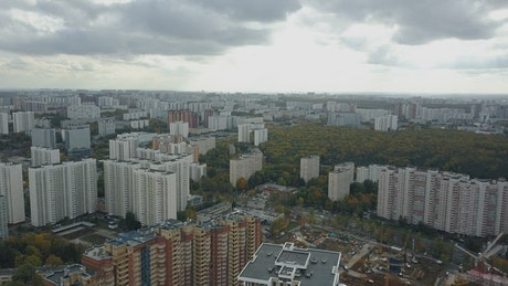 Large residential area under clouds