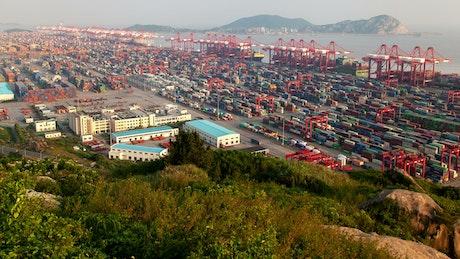 Large warehouses near a coastline, aerial shot