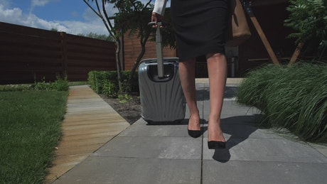 Lawyer walking with her suitcase