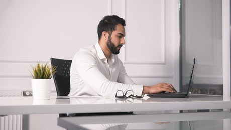 Lawyer working on laptop turns and smiles