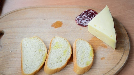 Laying out sandwich ingredients