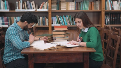 Learning partners study in university library