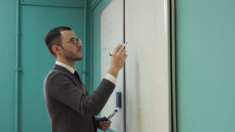 Lecturer writing on a board