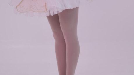 Leg warming up of a ballet dancer