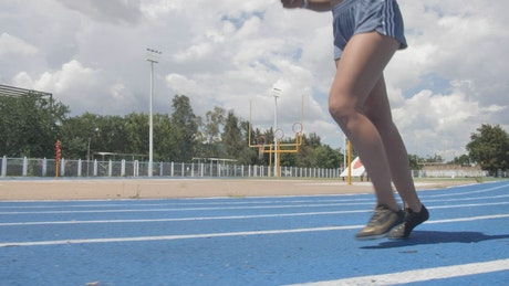 Legs of a woman when running on a running track