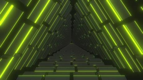 Lemon-green neon-lit triangular passageway tour