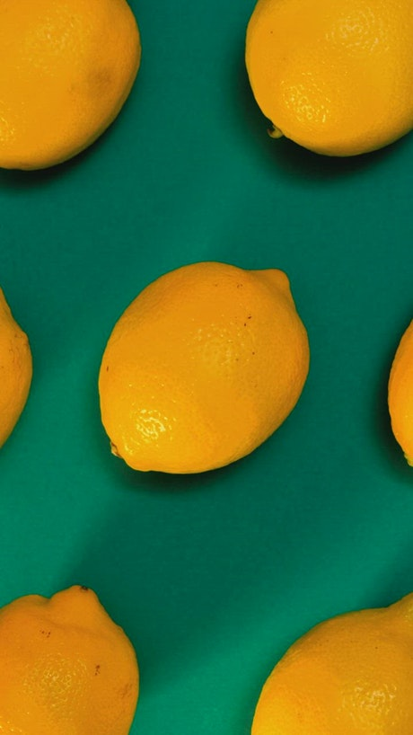 Lemons placed on a green surface