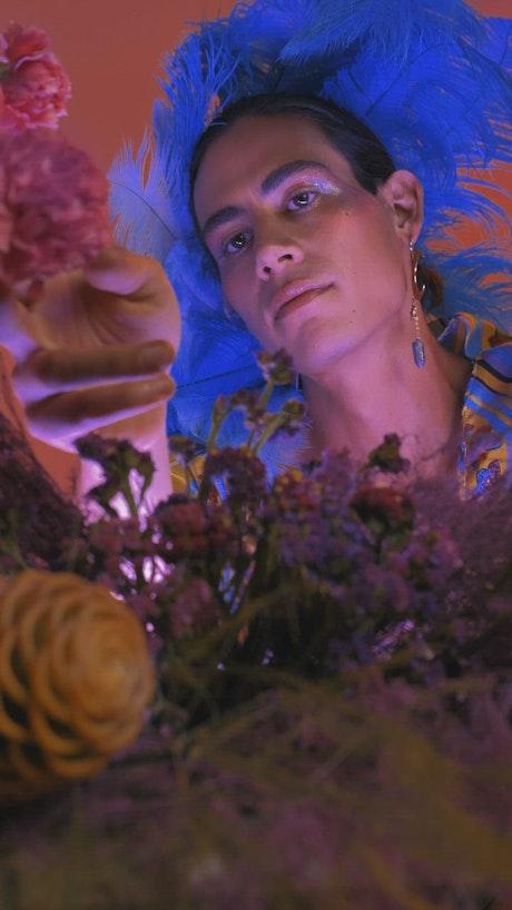 LGBTQ man appreciating and smelling flowers