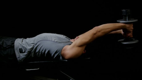 Lifting weights while laying down