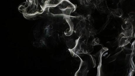 Light smoke lines on black background