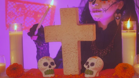 Lighting the candles of an altar of the dead