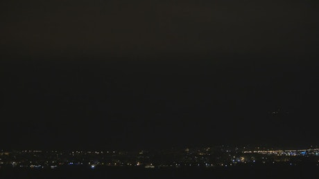 Lightning breaking through the night sky