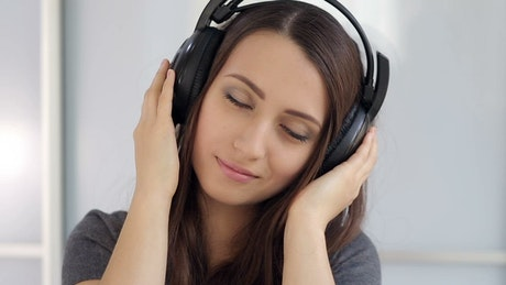 Listening to music on his headphones