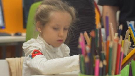 Littel girl working on the classroom