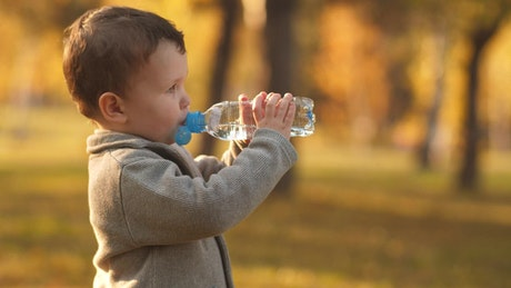 Little boy drinking water from a bottle