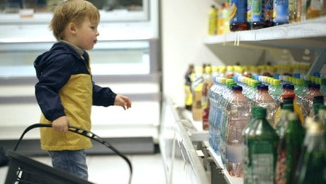 Little boy helping with the shopping