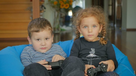 Little children playing video games
