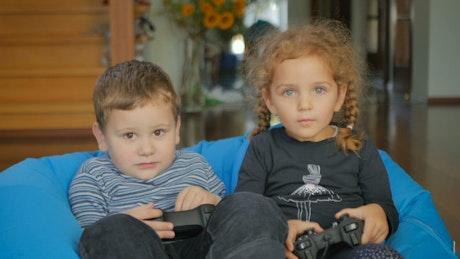 Little children playing video games