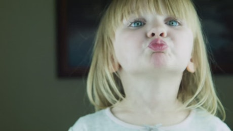 Little cute girl kissing to the camera