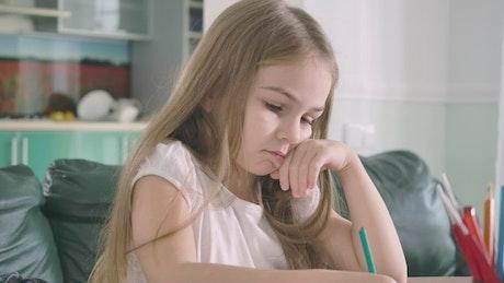 Little girl doing her math homework