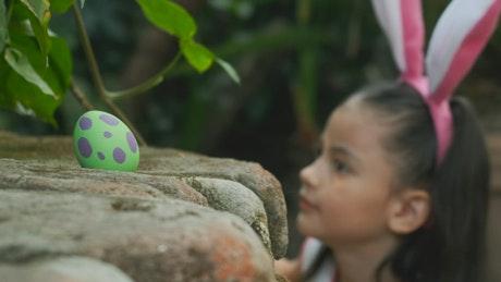 Little girl looking for easter eggs