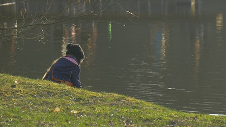 Little girl playing in the lakeshore