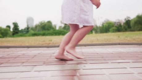 Little girl running in the rain