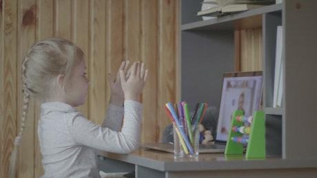 Little girl taking classes online