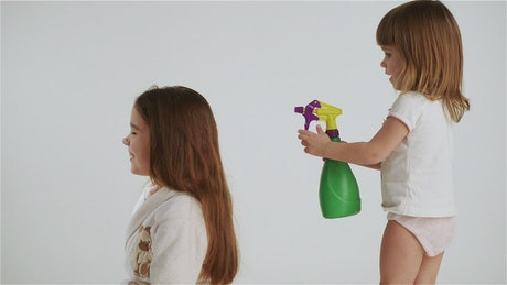 Little girls playing stylist