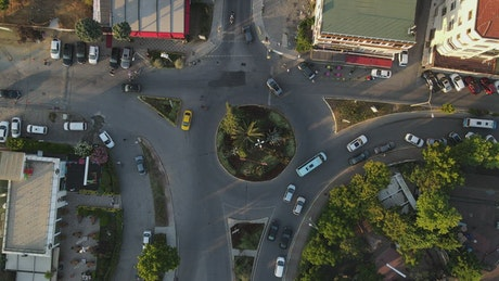 Little roundabout with traffic, top aerial view
