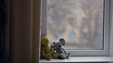 Little toys in the window in winter