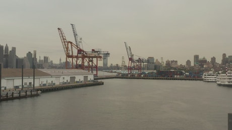 Loader cranes in the port seen from the river