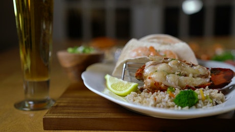 Lobster served with rice and lemon