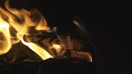 Log fire burning at night