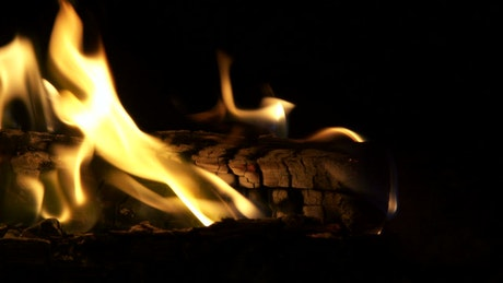 Log fire burning intensely at night