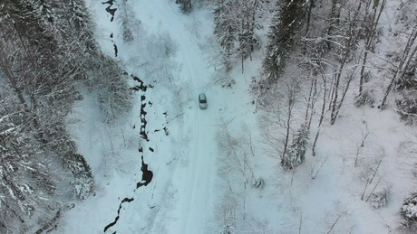 Lonely car driving on a snowy road