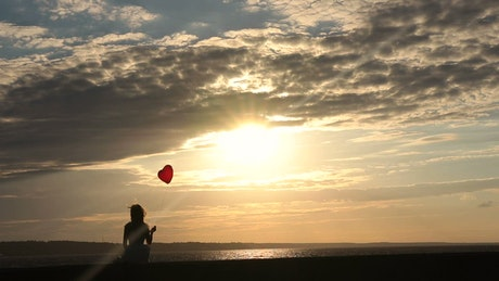 Lonely woman alone with a balloon