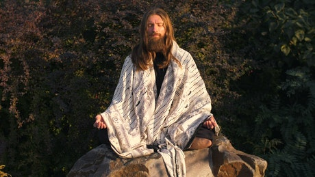Long beard man meditating