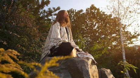 Long beard man meditating in nature