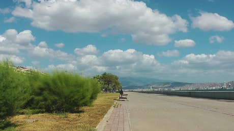 Long walker beside the sea on a sunny day