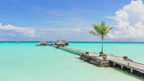 Long wooden pier on a paradisiacal beach