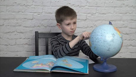 Looking at a globe