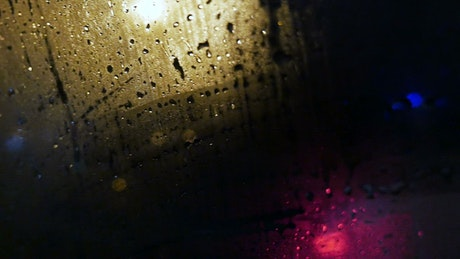 Looking out through a wet car window