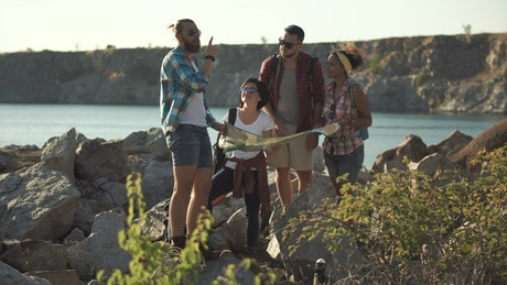 Lost tourists searching the map near the lake