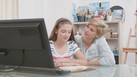 Loving mother helps girl with home education