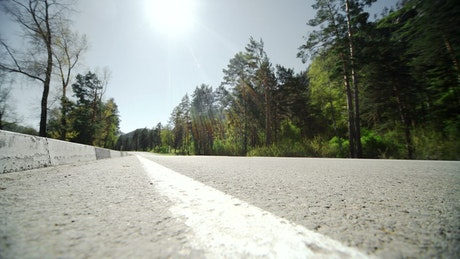 Low angle of runner jogging on forest road